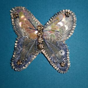 Papillon bleu brodé